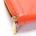 About Tory Burch Amanda Orange Leather Logo Continental Zip Clutch